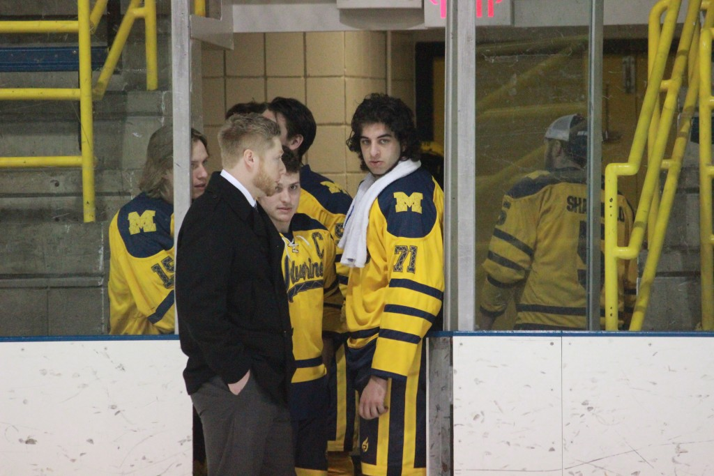 From left to right: Cody Longuski, Chris Haltinner, Jase Paciocco and Gino Darin await a decision regarding the ice during UM-Dearborn's series opener vs. Oakland Jan. 23, 2015. The game was cancelled after 33 minutes of game time and an hour delay due to thin ice. (Ricky Lindsay/MJ)
