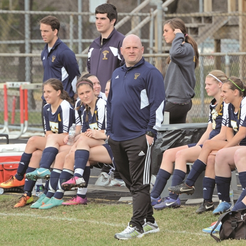 Mike Hatfield stands on the sideline during a Trenton High School soccer game. Hatfield, a longtime coach at UM-Dearborn, was announced as a women's soccer assistant at Adrian College on Jan. 12. (Photo courtesy MIPrepZone).