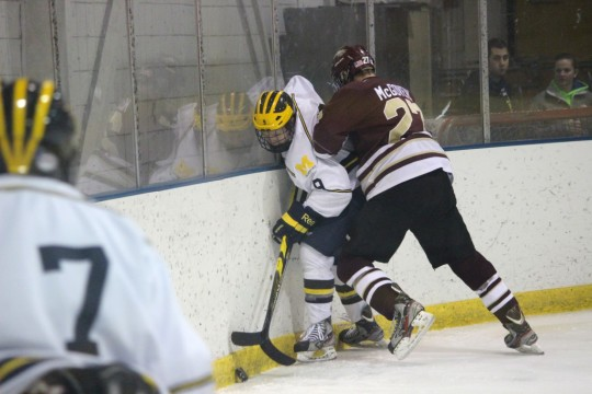 Ryan Kelly battles a Robert Morris defender for puck possession in a November loss to the Eagles. (Ricky Lindsay/MJ)
