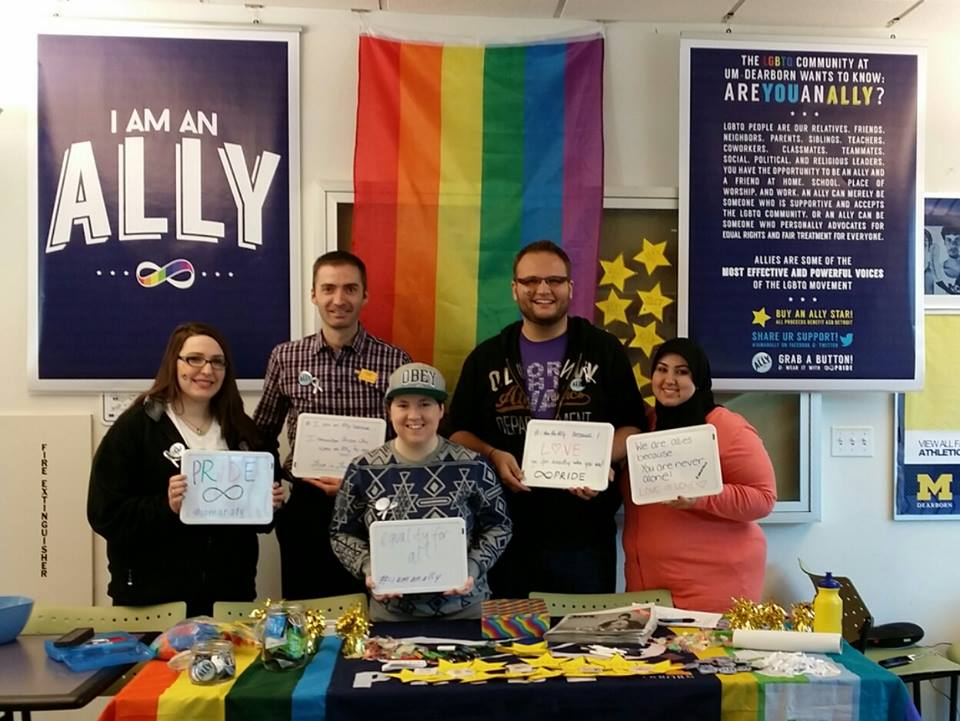 """Members hold signs in support of the LGBTQ community at their """"I am an Ally"""" event last semester."""