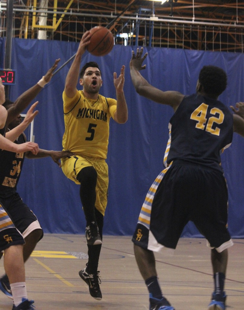 Khalil Beidoun drive men's basketball