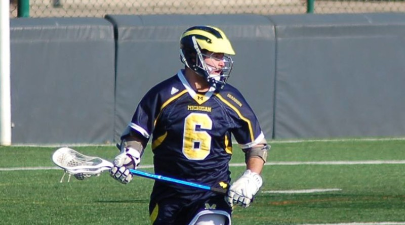 Dylan Hatcher surveys the field in UM-Dearborn's 17-7 win over Wheaton College on March 21. Hatcher scored six goals against the Thunder and broke UM-Dearborn's career goal record. (Photo courtesy I. Cabello)