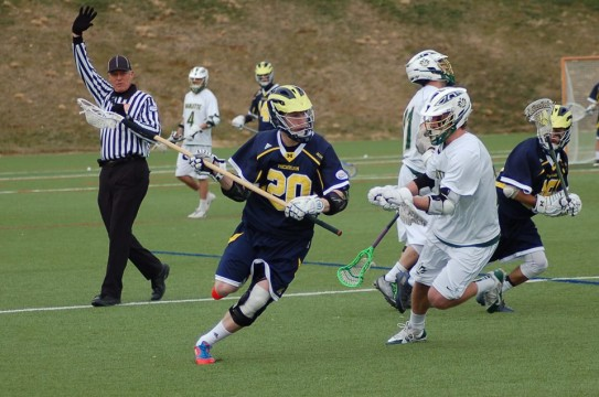 Andrew Dixon moves up the field during UM-Dearborn's 2015 season opener. (Photo courtesy of I. Cabello)