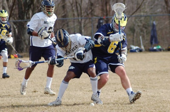 Dylan Hatcher battles a Montreat defender during UM-Dearborn's 10-0 win over Montreat on Feb. 22, 2015. (Photo courtesy of I. Cabello)