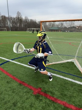 David Stephanoff warms up before UM-Dearborn lacrosse's season opener in North Carolina. Photo courtesy of I. Cabello.