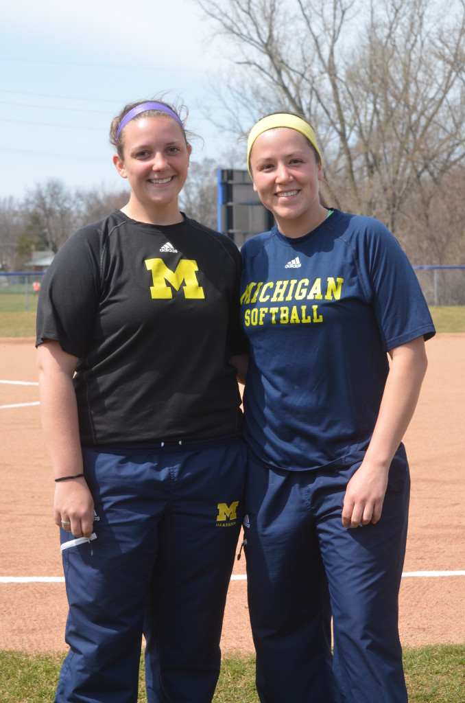 Rachel Riley and Veronica Niezgoda, former UM-Dearborn softball players, became team managers this season for the Wolverines. (Rebecca Gallagher/MJ)