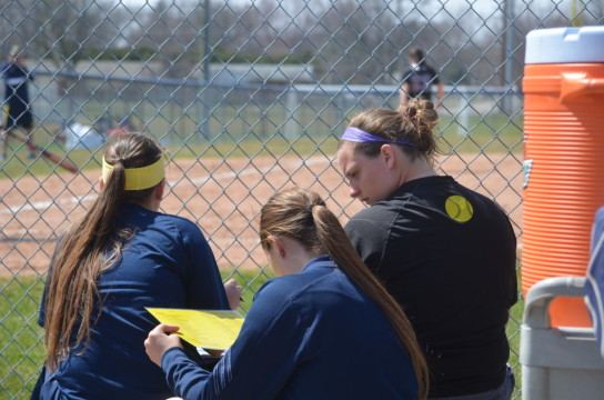 Rachel Riley and Veronica Niezgoda work during UM-Dearborn's doubleheader on April 12, 2015. (Rebecca Gallagher/MJ)