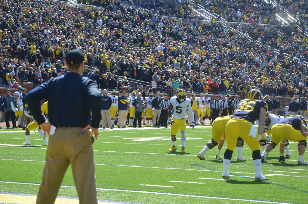 Jim Harbaugh (left) watches Jabrill Peppers (center) during Michigan's spring game. (Rebecca Gallagher/MJ)