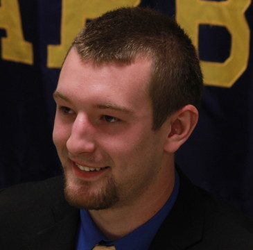 Troy Saunders smiles before signing with UM-Dearborn hockey on April 17, 2015. (Ricky Lindsay/MJ)