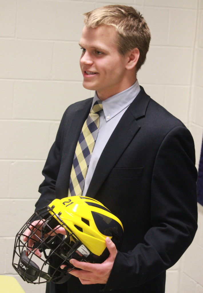 Tyler Dalton poses with the UM-Dearborn hockey helmet after signing on April 17, 2015. (Ricky Lindsay/MJ)
