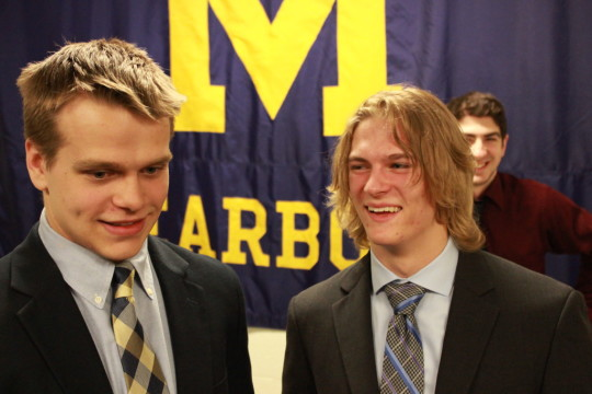 Former junior league teammates Tyler Dalton and John Barlow share a moment after signing with UM-Dearborn hockey on April 17, 2015. (Ricky Lindsay/MJ)