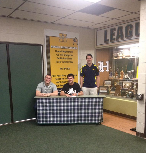Jake Wendel signs with UM-Dearborn men's basketball on May 19, 2015. (Photo courtesy Taylor Langley)