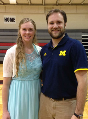 Jayci Forster poses with UM-Dearborn head coach Eric Stark after signing with the Wolverines in early May. Forster starred at Divine Child. (Photo courtesy of the Forster family)
