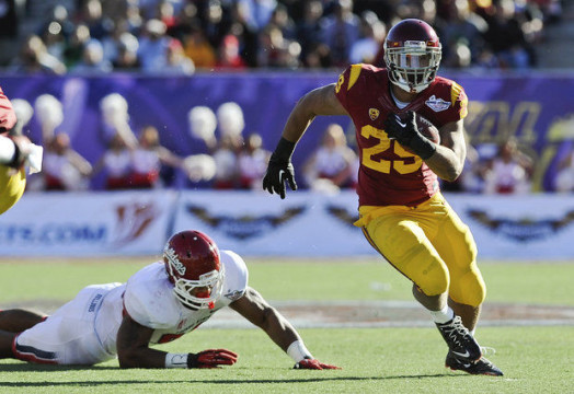 Ty Isaac, pictured with USC, is expected to be near the top of Michigan's running back competition. (Photo courtesy of AP)