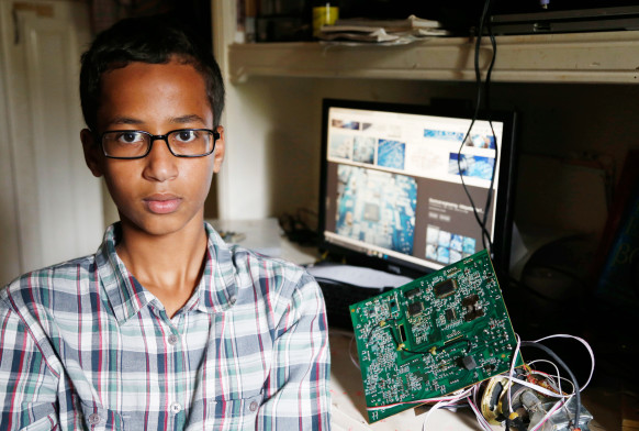 Irving McArthur High school student Ahmed Mohamed posing with one of his inventions at home.