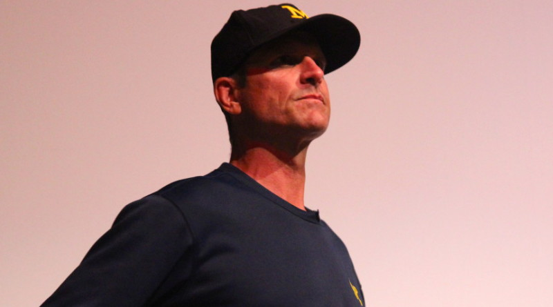 Jim Harbaugh waits to speak at adidas' Sound Mind Sound Body camp in June 2015. (Ricky Lindsay/MJ)