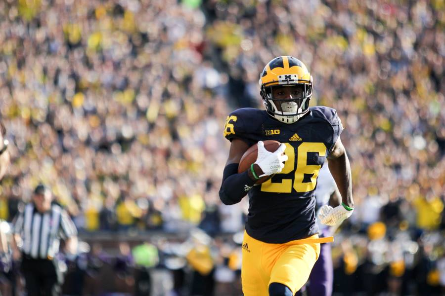 Jourdan Lewis returns an interception for a touchdown vs. Northwestern. (Amber Ainsworth/MJ)
