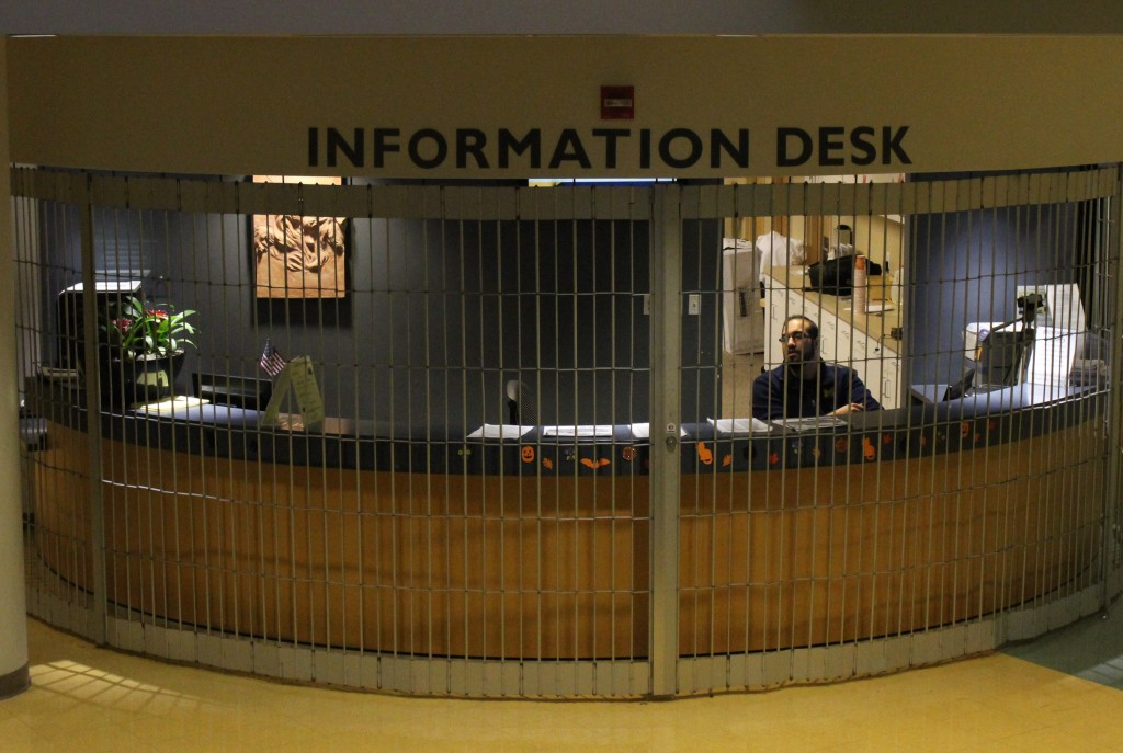The University Center Information Desk closed its gate after shots were fired at Fairlane Mall on Nov. 9, 2015. (Hannah Genig/MJ)