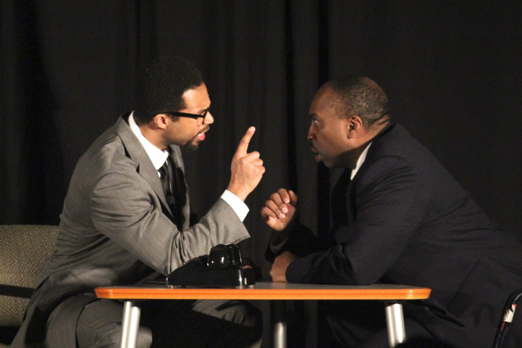 Don Snipes (Malcolm X, left) and William Bryson (Martin Luther King, Jr., right) argue during Thursday's showing of The Meeting, a stage play featuring a fictional meeting between the two Civil Right Movement leaders. (Ricky Lindsay/MJ)