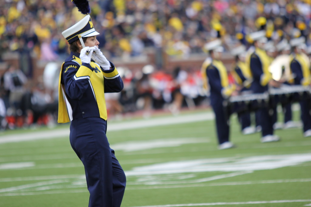 Sarah Shurge performs during Michigan football's season opener against Oregon State on Sept. 12, 2015. Shurge, a UM-Dearborn junior, has played in the band the past three football seasons. (Amber Ainsworth/MJ)