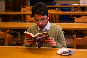 Yousuf Ali pictured reading the autobiography of Malcolm X. (Photo courtesy of Misba Saleem)