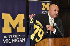 Warde Manuel, holding a Wolverines football jersey, was introduced as the University of Michigan's new athletic director on Jan. 29. (Photo courtesy of AP)