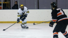 Sophomore John Barlow (64) loads for a wrist shot during the Wolverines' win over Indiana Tech on Saturday, Jan. 28, 2017.